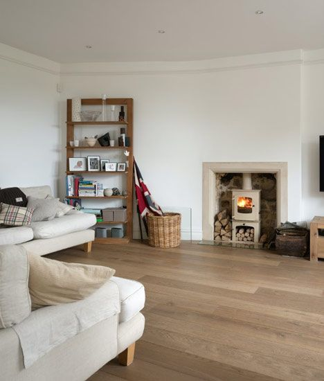 The Fosse by English architects Designscape. I don't think many homes in the UK look like this...lovely flooring and nice empty spaces.