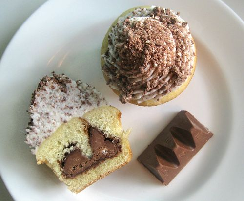 Toblerone Cupcakes - I made these and they are amazingly delicious!  Everybody who tried one loved them.  I could just eat the frosting straight from the bowl.