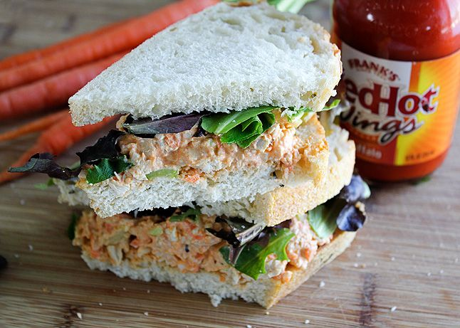 Recipe for a Buffalo wing-inspired chicken salad sandwich, made with bleu cheese, wing sauce, chopped celery, and shredded carrots.