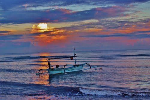Dolphins and Sunrise in Lovina, Indonesia Bali