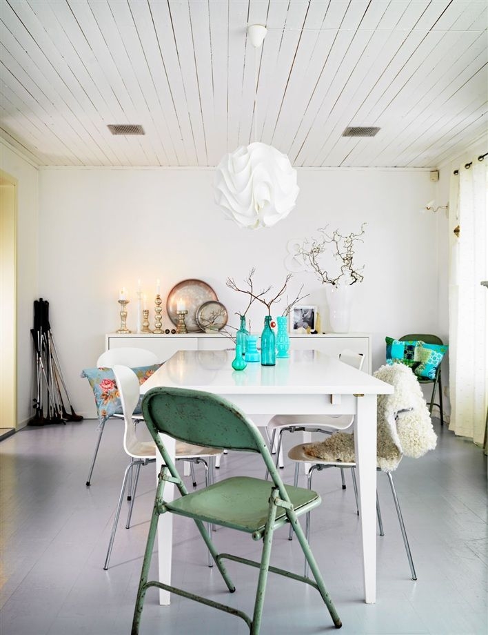 The eclectic and Boho vibe continues to the dining room where a mix of vintage and modern chairs completes a unique dining area. Our favourite shade of aqua reemerges in the scatters on display and a few perfectly poised glass bottles on show on the table.