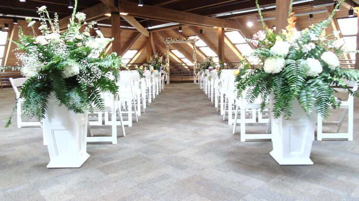 Kelly + Jason's ceremony in the Main Hall with beautiful florals that really set the tone for the ceremony