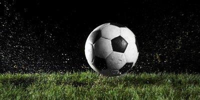 A football over wet grass
