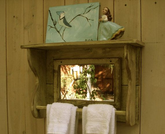 A handmade mirror shelf from honeystreasures...a multipurpose piece - great for a bathroom