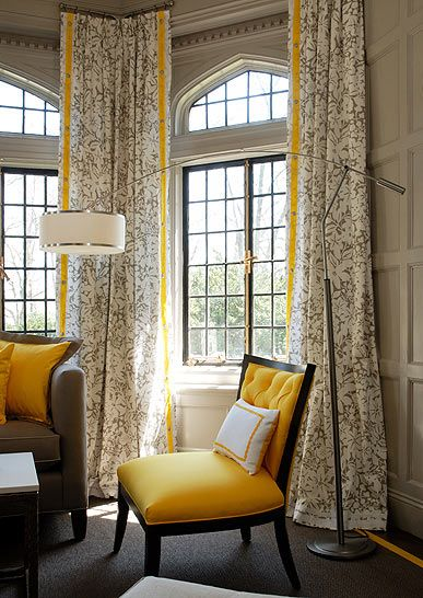 Dig the pop of yellow in these custom window treatments.