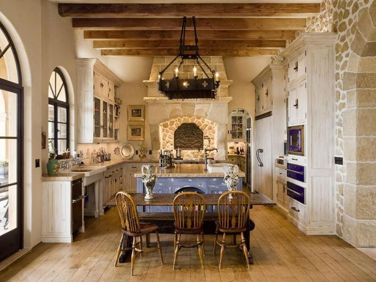 Mediterranean Kitchen with Wine refrigerator, Inset cabinets, Victorian windsor chairs, Exposed beam, Flat panel cabinets