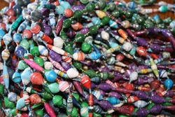 The Mowens are selling paper bead necklaces & t-shirts to help fund their adoption!