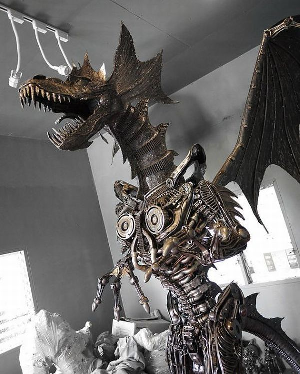It almost looks like a cross between an Alien and a dragon from this angle. - Giant Steampunk Dragon Made from Salvage