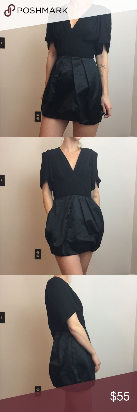 BCBGMaxAzria Runway Black Satin Bubble Hem Dress BCBGMaxAzria Dress so cute has some light tear along the center seam but is an easy fix. Not noticeable. So stunning. I'm 5'5 and it's super short on me. Best for shorter gals. BCBGMaxAzria Dresses