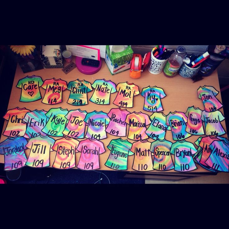 Probably my favorite door decs I've ever made!! Tie-dye tshirts that I made with cardstock and watercolor crayola paint..drew a shirt, copied on to more paper, cut, painted, laminated, name and room number!  #RA #doordecs #doortags #bulletinboards #residentassistant