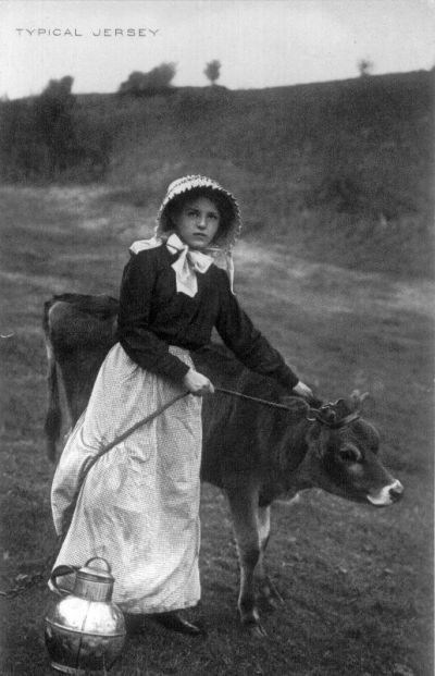 In 1796, Edward Jenner noticed that milkmaids who had contracted cowpox, were immune from catching smallpox.  He used this information to develop a vaccine for smallpox.  Milkmaid, Jersey cow:  another old postcard from Jersey, England.