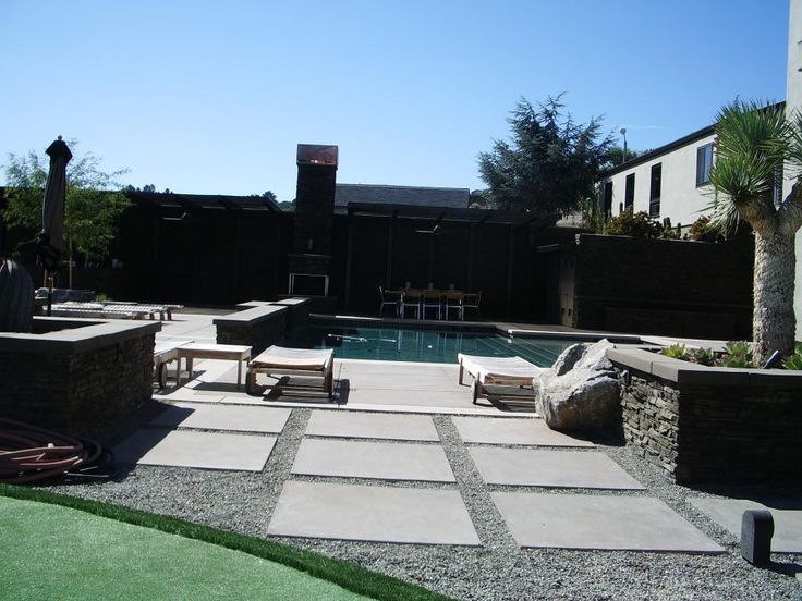 This backyard swimming pool area in carmel features clean for Low maintenance pool landscaping