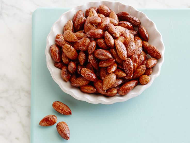 Sweet and Spicy Roasted Almonds : Toss nuts with a sweetener like ...