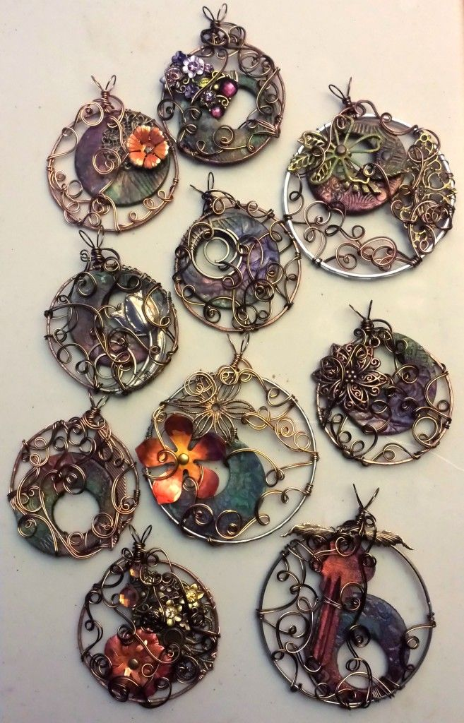 Polymer clay with swellegant patina, copper soldered rings, metal and wire wire wrapping. Beautiful!