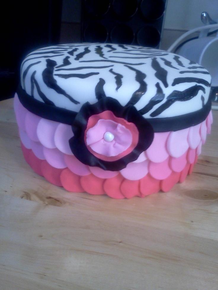 Strawberry white chocolate amaretto cake. zebra printed/pink