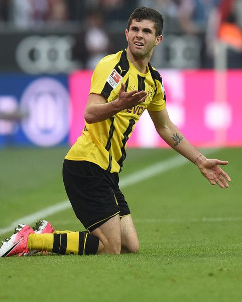 Dortmund's US midfielder Christian Pulisic reacts after a challange during the German first division Bundesliga football match FC Bayern Munich v BVB Borussia Dortmund in Munich, southern Germany, on April 8, 2017. / AFP PHOTO / Christof STACHE / RESTRICTIONS: DURING MATCH TIME: DFL RULES TO LIMIT THE ONLINE USAGE TO 15 PICTURES PER MATCH AND FORBID IMAGE SEQUENCES TO SIMULATE VIDEO. == RESTRICTED TO EDITORIAL USE == FOR FURTHER QUERIES PLEASE CONTACT DFL DIRECTLY AT + 49 69 650050.