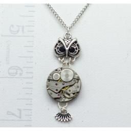 Owl Necklace : The pendant is the head and tail of an owl and the body is the mechanism of an antique watch.