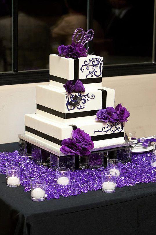 black and purple detailed square white wedding cake
