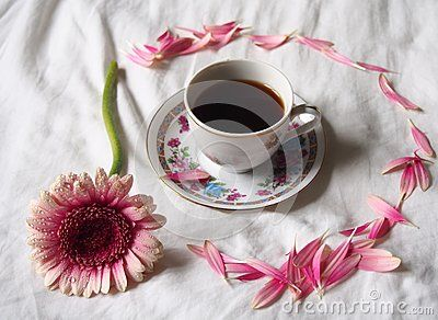 A cup of coffee with beautiful flowers
