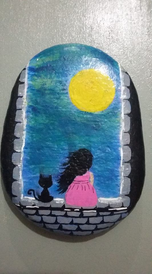 Cutest painted rock ever! Little girl sitting in a castle window with her cat looking out at the yellow moon.