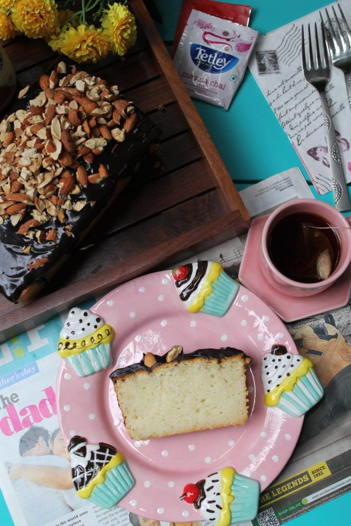 Almond Loaf Cake with Chocolate Glaze and Toasted Almonds-The buttery soft cake is a lovely bake with a moist crumb that just melts in the mouth.
