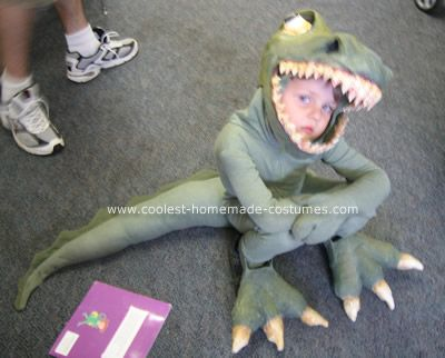 T-Rex Costume: My four year son was obsessed with T-Rex's last year, so Mom had to deliver! I made his T-Rex head out of a children's plastic fire fighters helmet. I