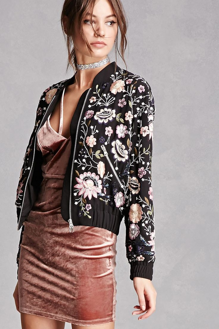 A woven bomber jacket featuring ornate floral embroidery and beaded embellishments, a basic collar, zipper front, long sleeves, zippered front pockets, and elasticized trim.