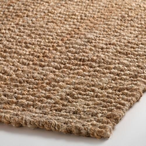Natural Basket Weave Jute Rug | World Market I have this rug...great price, hides everything and so much softer than you think it would be.