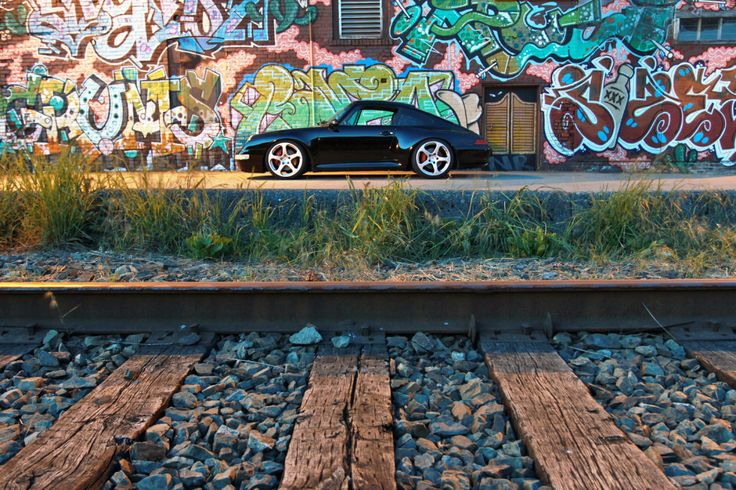 "Graf murals and a Porsche 993 Carrera 4S sitting on 19"" RUF wheels. #everyday993 #Porsche"