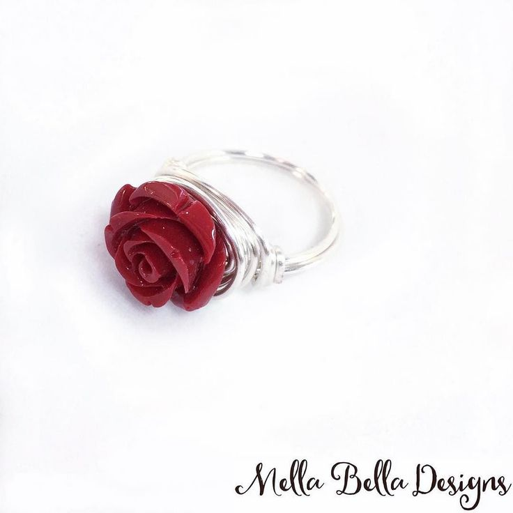 This little beauty made its debut at the Capital Ukrainian Festival last weekend and ended up being a bestseller!  I'll make some more and list them in my shop soon so that you can get one too! . #ringlover #wirewrappedring #redrose #mellabelladesigns