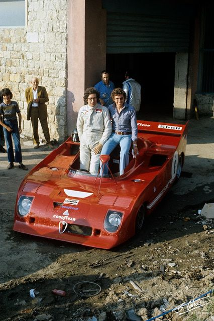 Backyard presentation of a Alfa Romeo Tipo 33 with Stommelen and de Adamich ca. 1972