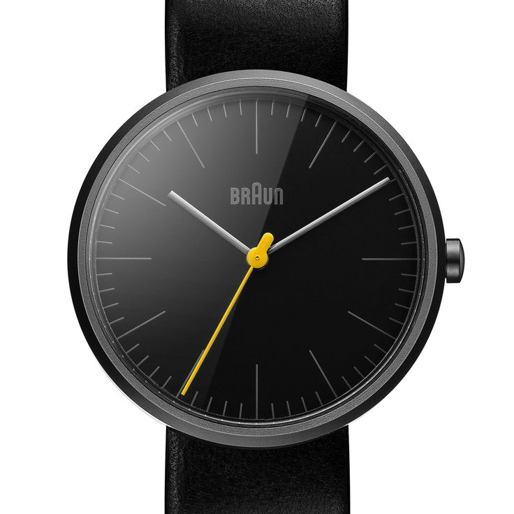 The BN0172 watch by Braun features an all-black silhouette and a contrasting yellow seconds hand. #Braundesign #luxurywatches #DieterRams