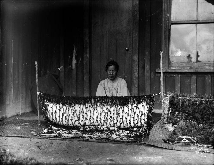 woman weaving a korowai: flax cloak | probably in the Rotorua District, New Zealand | 1905 | Thomas Pringle: photographer