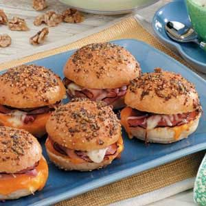 "Hot Colby Ham Sandwiches Recipe -""This yummy recipe is a favorite with friends and family,"" assures Sherry, Crenshaw, Fort Worth, Texas. ""Not only are the warm sandwiches easy to assemble, but they smell so good when baking that no one can resist them. They're a staple at our get-togethers."""