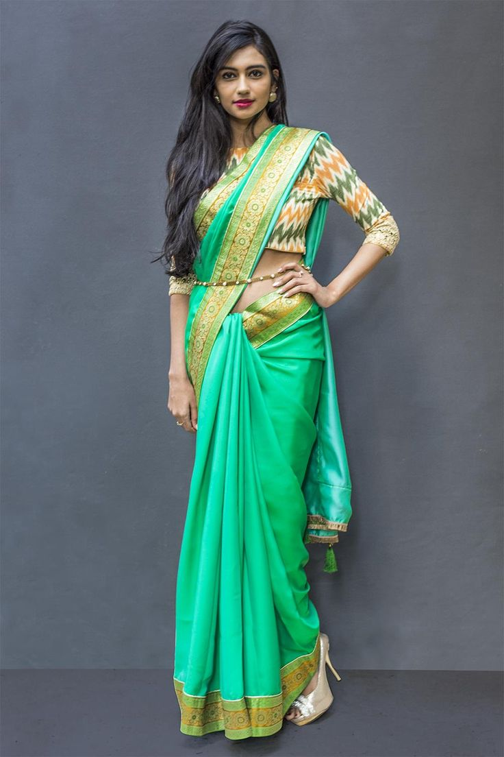 A drapey satin crepe saree in green with a traditional brocade border in mustard green gold. This lovely and versatile saree can transition effortlessly from a wedding to a dinner party and more. Got an art soiree to attend? Pair this with a trendy Ikat blouse and shine through! A friends wedding? Go for a mustard brocade blouse and be the demure lady in attending. #houseofblouse #saree #blouse #indianwear #india #fashion #bollywood #green #gold #satin #crepe