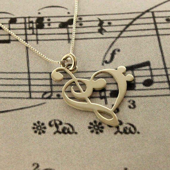 This teensy clef heart necklace ($45). // music lovers jewelry
