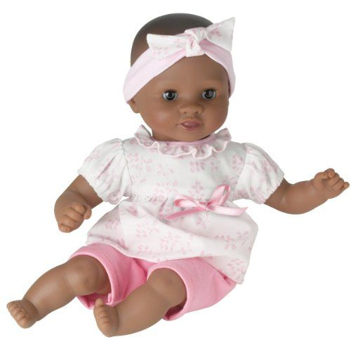 $28.85 Corolle Mon Premier Calin Naima Baby Doll. Calin Naima is the ideal first baby doll for the littlest mommies ages 18 months and up. This adorable 12-inch baby doll is just the right size to cradle in a young childs arms. She has a cuddly soft beanbag body, so she can be posed like a real baby, and supple vinyl skin that is delicately scented with vanilla -- a Corolle signature. Soft bean-filled body is perfect for hugging and cuddling. Smooth, supple vinyl skin is delicately scented