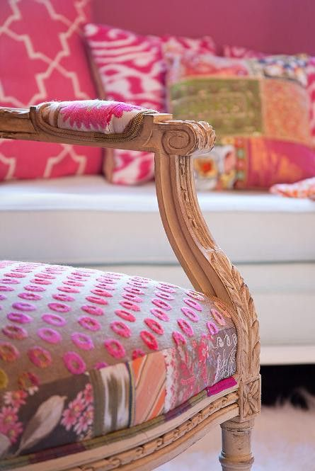 I love it when modern upholstery is mixed with antique furniture. :)