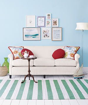 Love this simple white sofa with the bright and vintage items placed around the living room.
