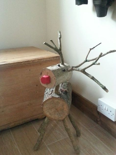 Reindeer made from logs.: