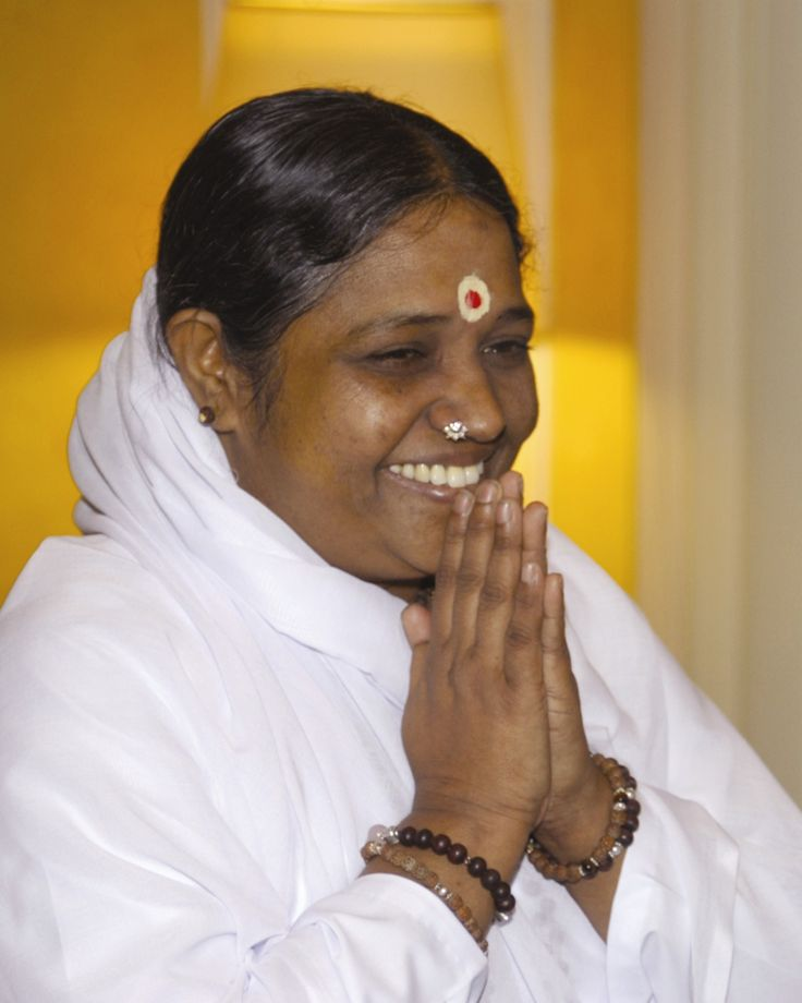 Amma, by all accounts an amazingly compassionate human being
