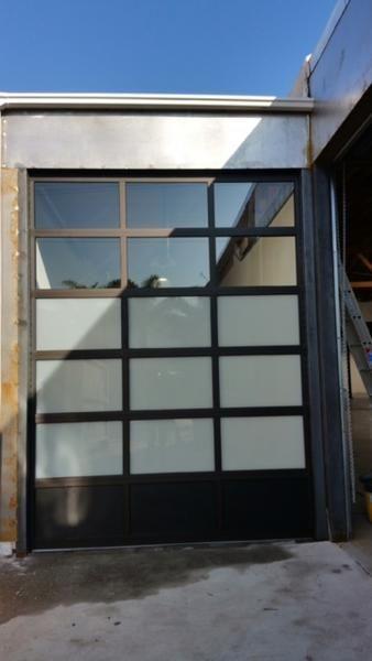 4fdc842c644 Contemporary Black Aluminum   White Laminate (Privacy) Glass Garage Door