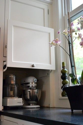 Hinged cabinet for hiding large items- great idea