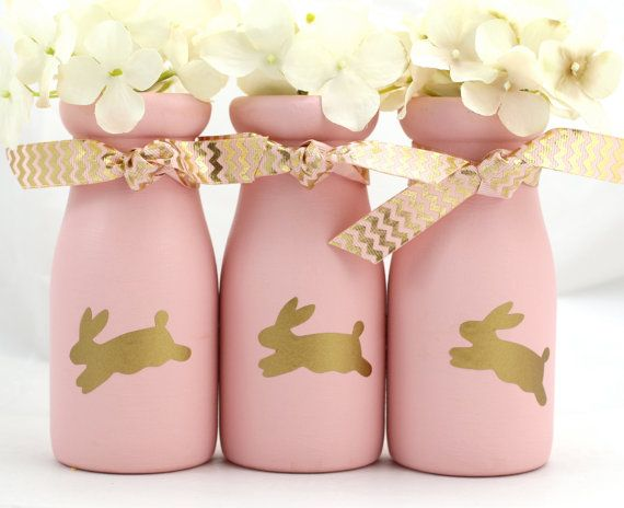 Bunny Baby Shower Centerpieces Girl Baby Shower Decorations Bunny Nursery Decor Bunny Birthday Party Bunny Rabbit Hostess Gift Milk Bottles  Precious little bunnies hop across this set of three pink painted milk bottles. Ready for water and fresh flowers, use these cuties for your bunny rabbit baby shower...or divide them and give as hostess gifts.  This listing is for three pink painted milk bottles, the pink and gold ribbon, and three bunny stickers.  Would you like the cream colored…