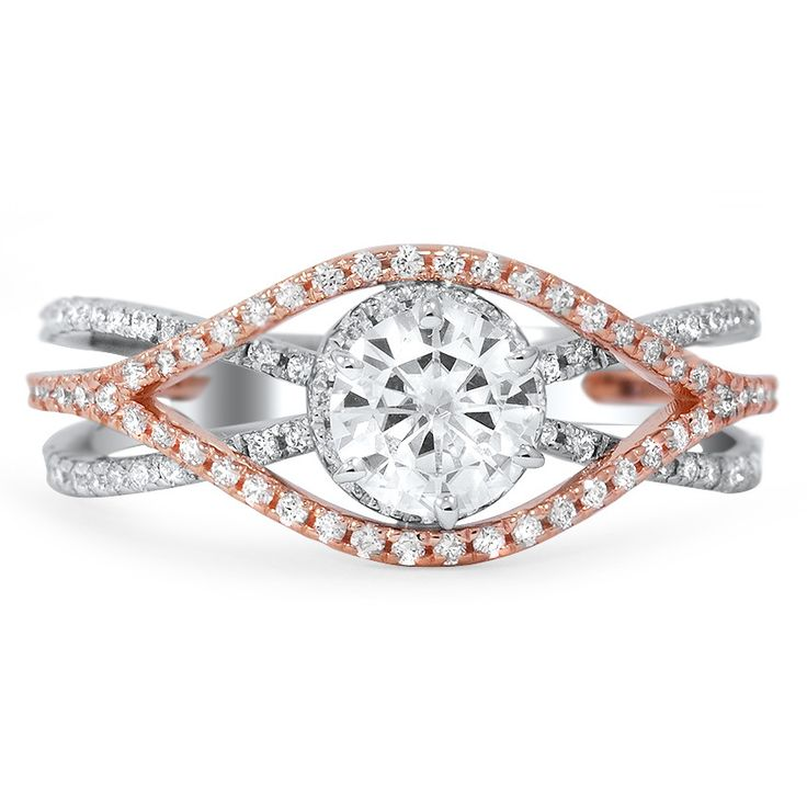 WOVEN MIXED-METAL DIAMOND RING Both white gold and rose gold grace this six-prong engagement ring. A round enhanced moissanite is featured as the center stone while ninety diamond accents adorn the woven band.