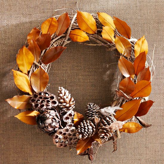 Leaves and Pinecones Fall Wreath - Make gorgeous wreaths that last from Halloween through Christmas, like this brown-and-gold arrangement. Wire dried artichokes, lotus pods, and pinecones to the bottom of a grapevine wreath. Tuck brown- and gold-tint leaves between the wreath's twigs, securing with hot glue if needed. /v