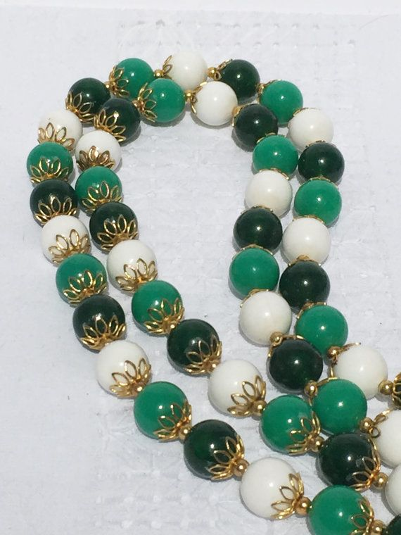 This fun necklace measures an impressive 65 inches and has a clasp so it can be worn as a double or triple strand. The beads an alternating
