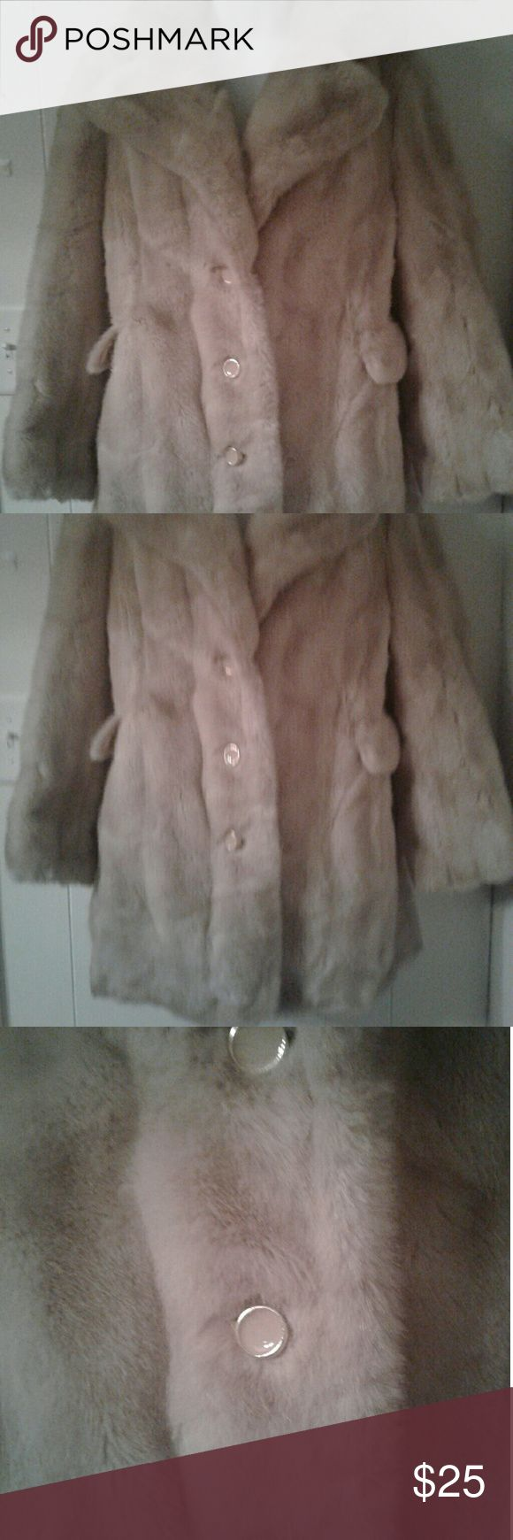 Tissavel vintage faux fur coat Tissavel vintage faux fur coat. Please look at all pics & read the discription* This jacket says imported from France but has a made in the U.S.A. label. That's a head scratcher to me because I don't know much about vintage clothing.  The inside shell has some age stains & spots. The lining is coming loose from bottom & can easily be sown. The outside has some stains as noted in pic but there wasn't room to post pics of all stains. If dry cleaned I think this…