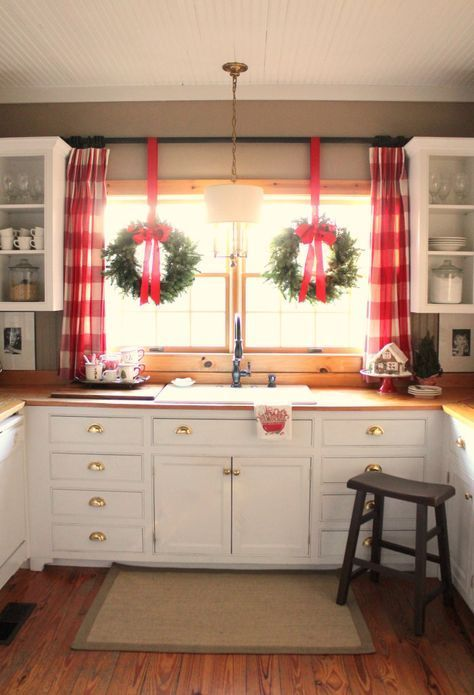gingerbread house on cake stand, large red plaid curtains