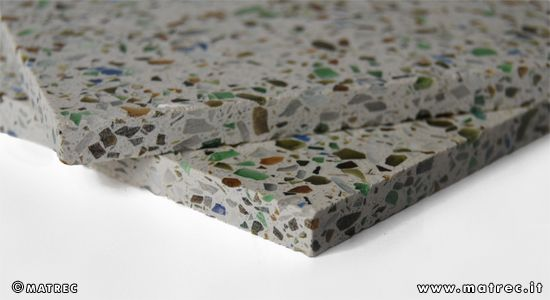 MATREC code: RGLA0242 Quartz slab containing recycled glass flakes.